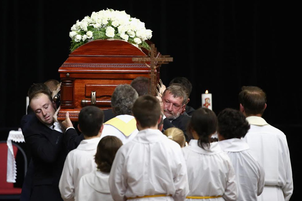 Emotional farewell for Hughes
