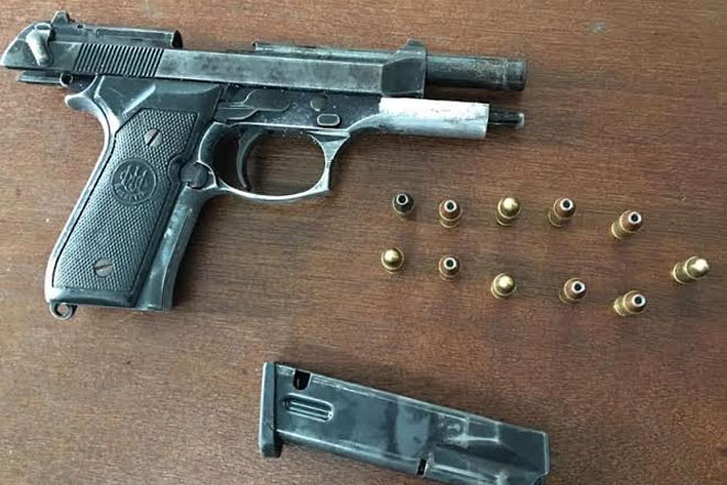 Illegal gun seized; Wanted man turns himself in