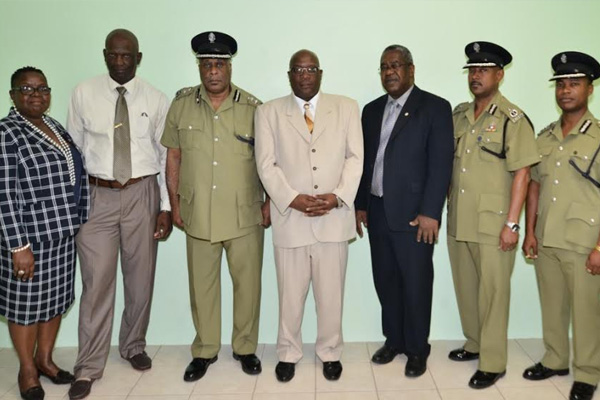 Police Officers salute PM Harris' strength of character