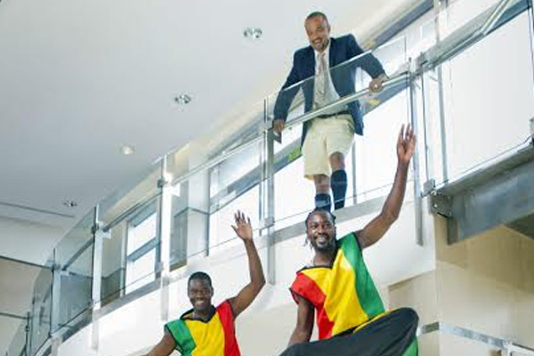 Kittitian stilt walkers pay courtesy call on Bermuda's Culture Minister