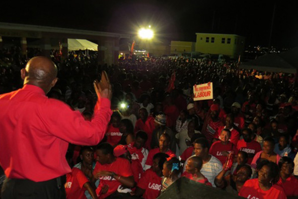 "Thousands turned out Saturday night to support PM Douglas and his Labour Party, ""Let them wait,"" he tells massive crowd"