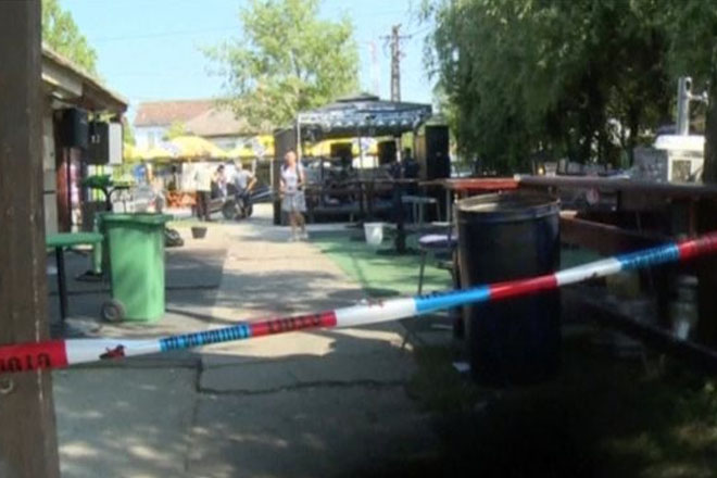 Serbia cafe killing: Gunman shoots wife and four others, injuring 20