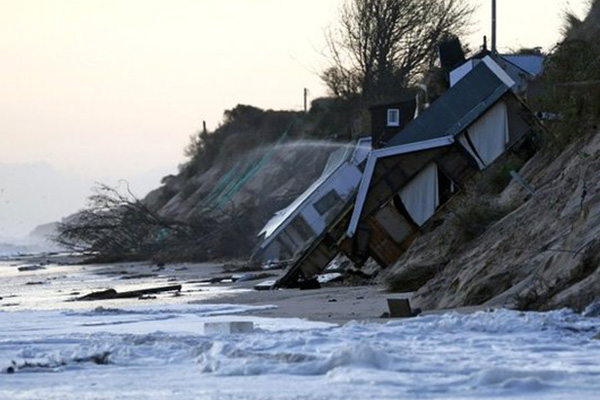 Tidal surge hits east UK coastal towns after storm