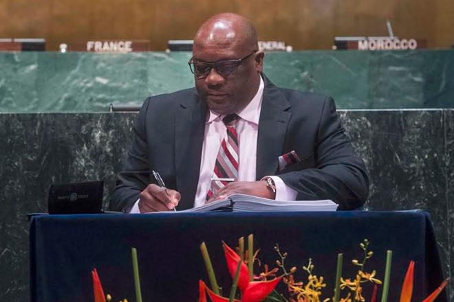 PM Harris signs landmark Paris Agreement