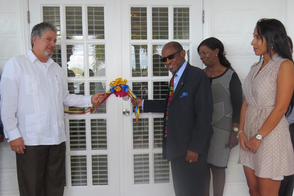 PM Douglas and Ambassador González cut ribbon for new Venezuelan Embassy
