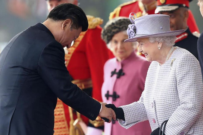 Welcomed with pageantry and protests, China's Xi hails 'bright' ties with Britain