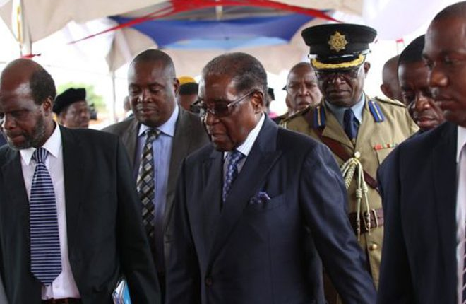 Zimbabwe latest: Defiant Mugabe makes first public appearance