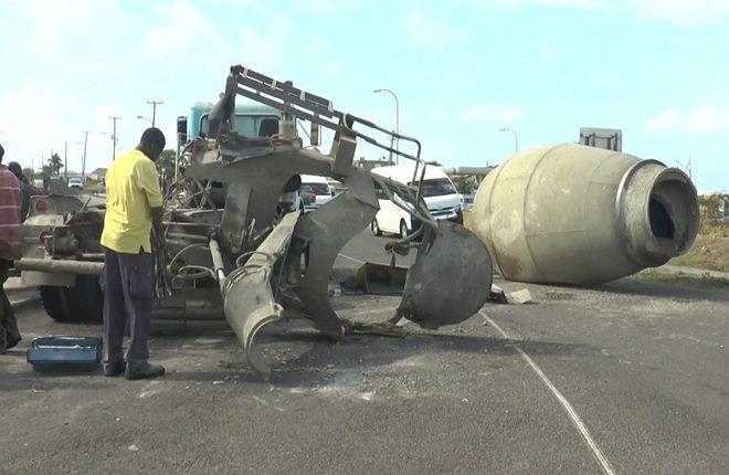 Cement truck loses barrel