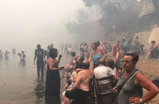 Greece wildfires: At least 74 dead as blaze 'struck like flamethrower'