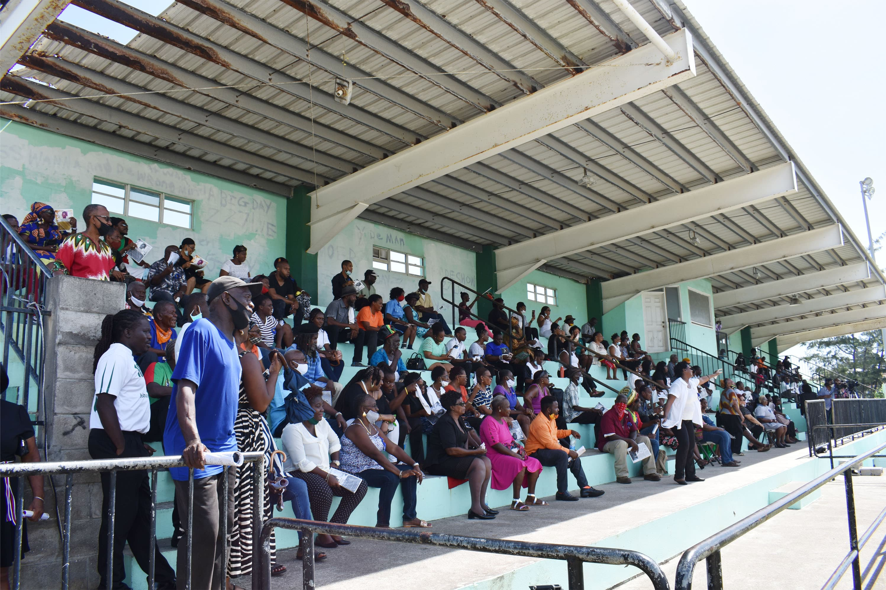 A section of the crowd that had attended the funeral service at Garden's Playfield.