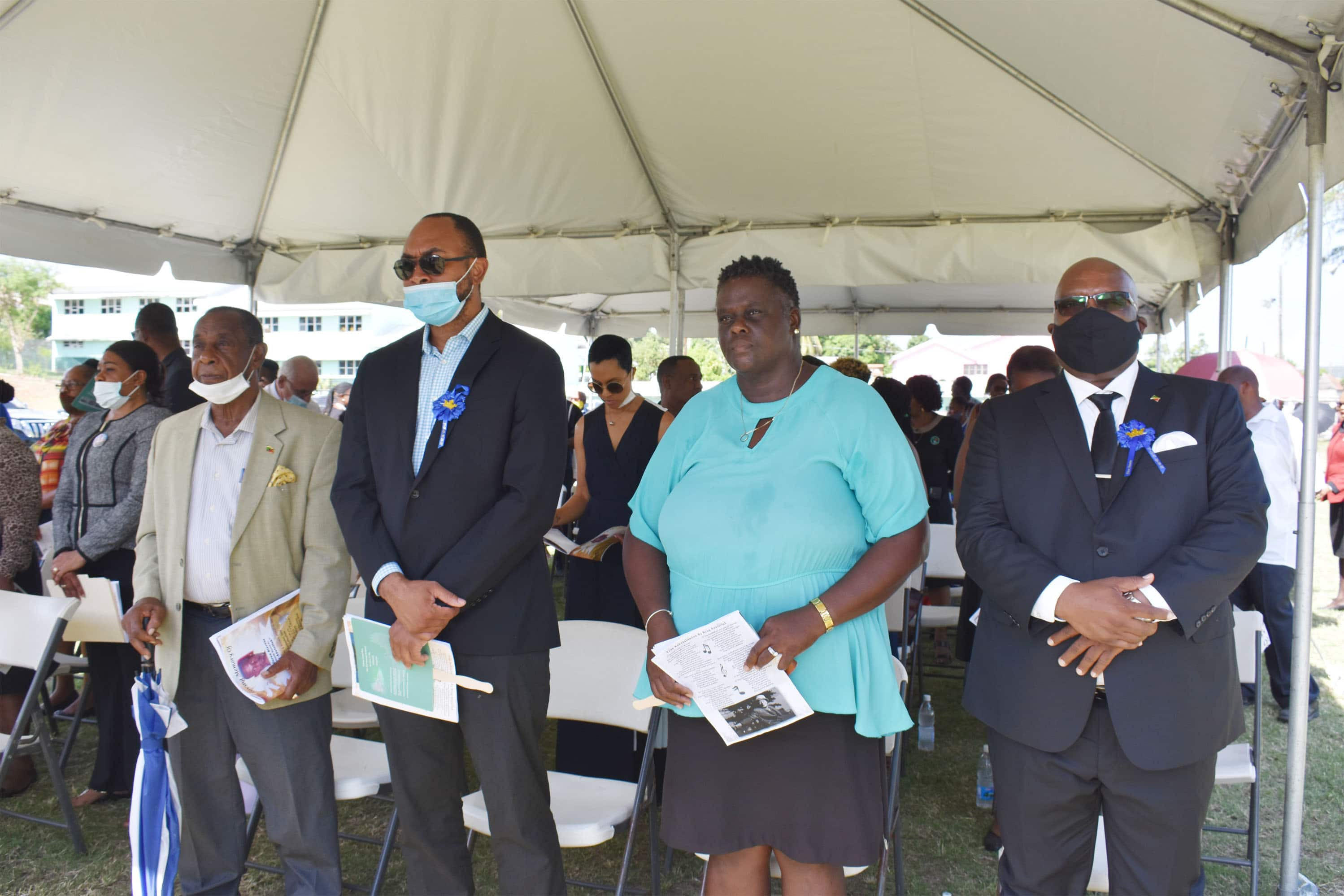 Prime Minister Harris, right, with Ms Verlyn Warner, the Hon Jonel Powell, and Mr Stanley Franks during the funeral service held at the Garden's Playfield.